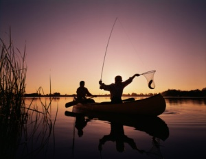 sunset canoe fishing