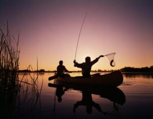 sunset canoe fishing